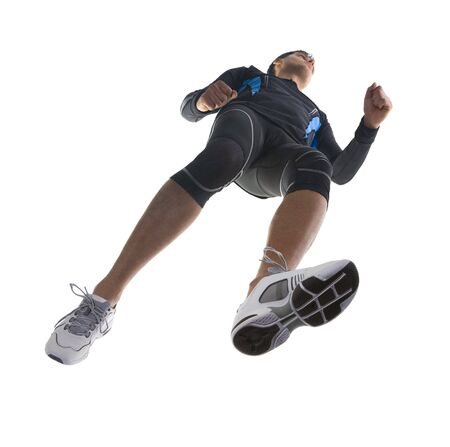 Young running athlete. Wearing tight-fitting uniform. Low angle view Stock Photo - 2605901