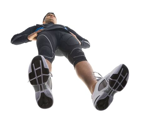 Young, resting runner. Wearing tight-fitting uniform and standing straight. Low angle view Stock Photo - 2605883