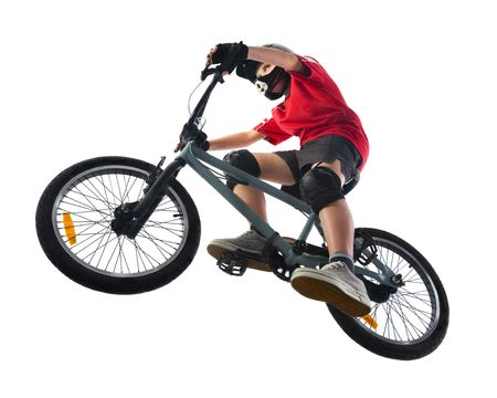 Young boy in red T-shirt cycling on BMX. Unusual angle view - directly below. Stock Photo - 2607012