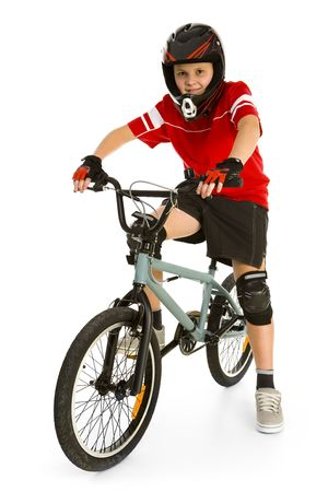 Happy boy in helmet on BMX and looking at camera. Isolated on white background. photo