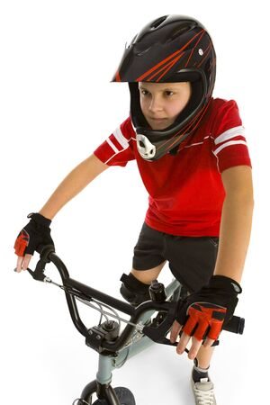 Young boy on bike and concentrated before cycling. Front wiev. White background. photo