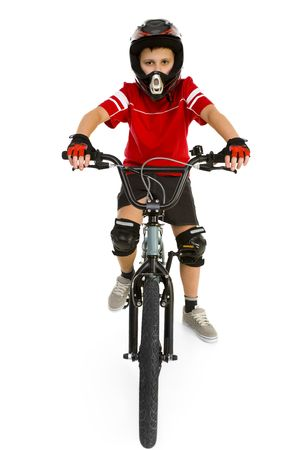 Young boy in helmet and protection kit sitting on BMX and looking at camera. Front view. Isolated on white background. Stock Photo - 2606650