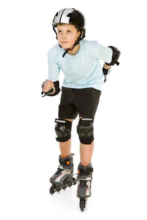 inline skates: Young skater boy ready to ride on roller skates. Hes looking at something. Front view. Isolated on white background. Stock Photo