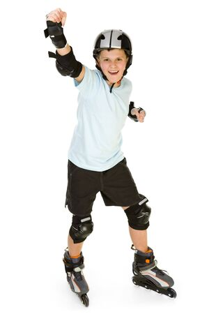 inline skates: Young, happy roller boy in protection kit standing with hand up and looking at camera. Front view. Isolated on white background.