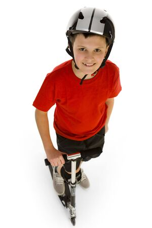 somewhere: Happy boy dressed red T-shirt riding on his scooter and looking somewhere. High angle view. Isolated on white background.