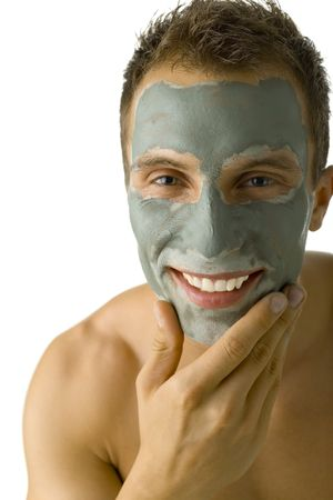 Young, handsome and  man with green mask on face. Smiling and looking at camera. White background, front view photo