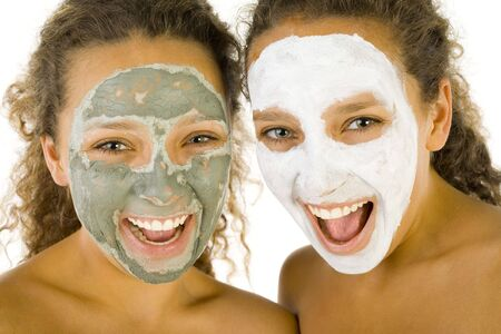 Happy young women with masks anti-aging. Theyre on white background. Front view