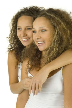 Happy twins in embrace. They're on white background. Stock Photo - 2607383