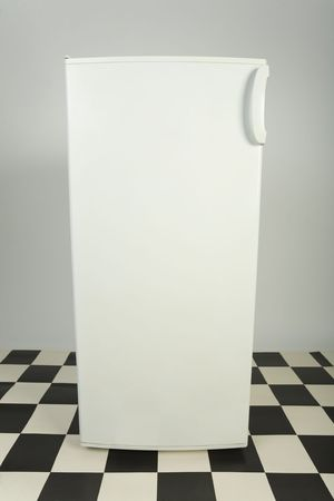 Closed white fridge. Front view photo