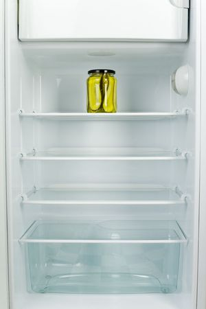 icebox: Lonely jar of gherkins in fridge. Front view