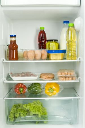 eatables: Foodstuffs in fridge. Front view.