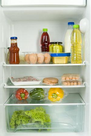 foodie: Foodstuffs in fridge. Front view.
