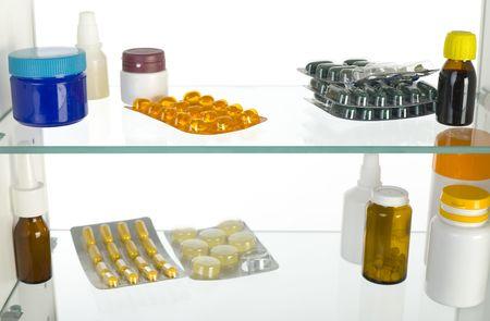pastil: Medicaments in medicine chest. White background.