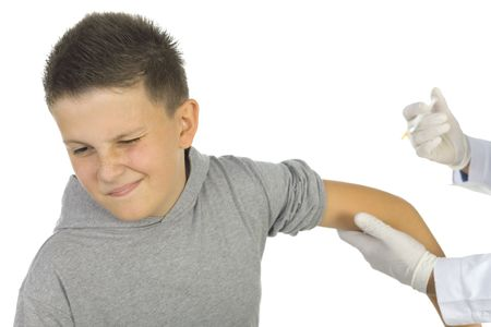 vaccinating: Doctor vaccinating a boy. White background. Stock Photo