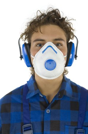 protectors: Young male worker with dust mask and hearing protectors. Looking at camera. White background Stock Photo