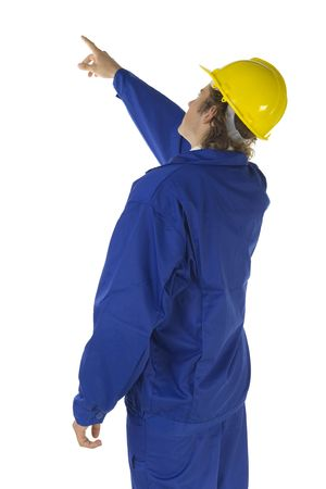 protective clothing: Male worker showing something overhead. Isolated on white background
