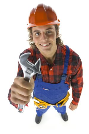 adjustable: Young builder with adjustable wrench in hand looking at camera. Isolated on white background. High angle view. Stock Photo