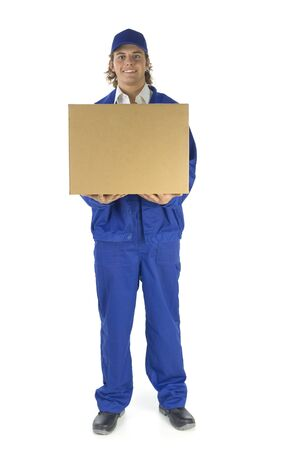 portage: Young male courier holding carton box. Hes looking at camera. Isolated on white background. Front view Stock Photo