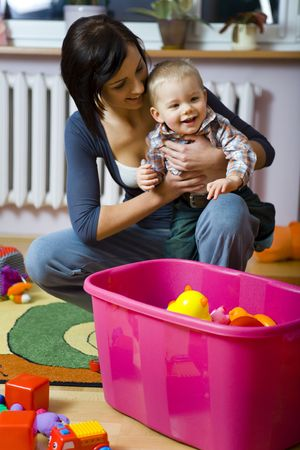 Young woman with  boy during plaing. Front view. photo