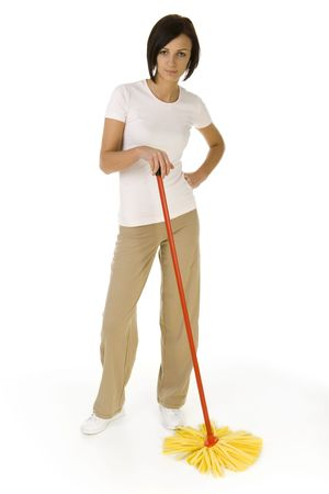 Young woman standing with hand on hip and mop in second hand and looking at camera. Whole body. Front view. White background. photo