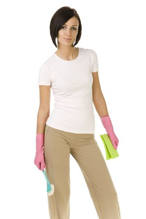 Young woman standing and holding in hands washcloth and scrubbing brush. Looking at camera, front view. White background. photo