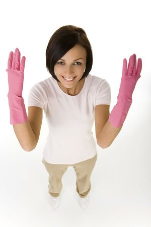 houseclean: Young happy woman in pink rubber gloves with raised hands. Looking at camera, high angle view. White background.