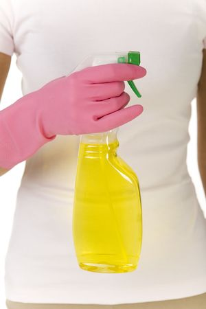 Young woman standing and holding in hand bottle of cleanser. Looking at camera, front view. Closeup on hand with bottle. White background. Stock Photo - 2651550