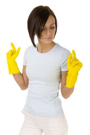 Young woman in yellow rubber gloves with raised hands. White background. photo