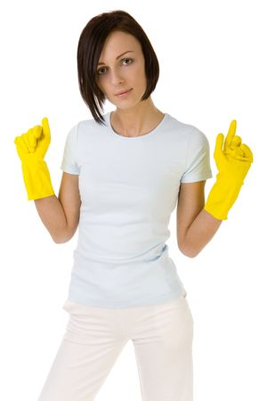 Young woman in yellow rubber gloves with raised hands. Looking at camera, front view. White background. photo