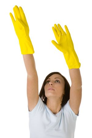 houseclean: Young woman in yellow rubber gloves with raised up hands. Shes reach to something. Front view, white background.