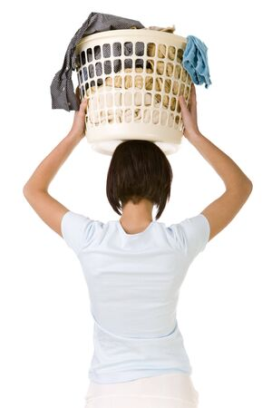 Young woman holding full laundry basket over head. Rear view, white backgroun. photo