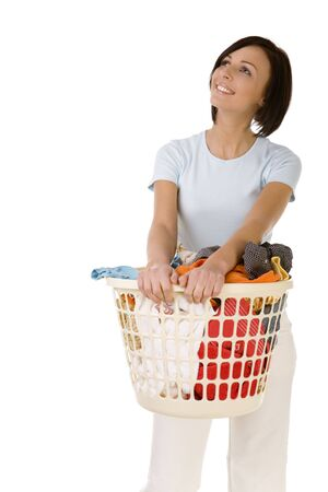 Young happy woman standing with full laundry basket. Shes looks like moony. Front view, white backgroun.