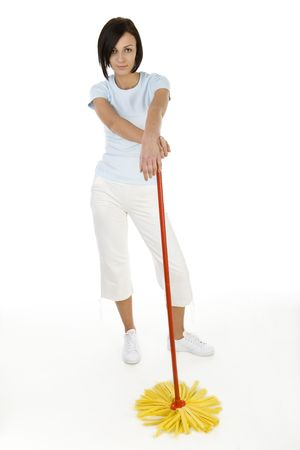 Young woman standing with mop and looking at camera. Whole body. Front view. White background. Stock Photo - 2651506