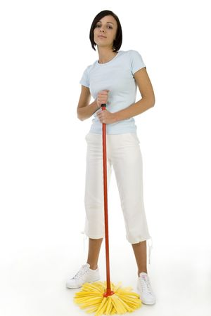 Young woman standing with mop and looking at camera. Whole body. Low angle view. White background. photo