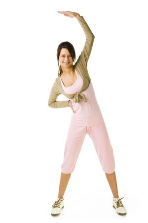 Young woman in pink sportswear during exercising. Looking at camera and smiling. Whole body. Front view. White background. Stock Photo - 2852421