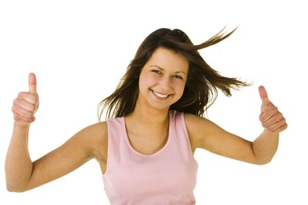 Young woman showing OK. Looking at camera and smiling. Front view. White background. photo
