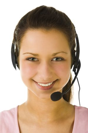 telephonist: Young woman with headset looking at camera and smiling. Closeup on face. Front view. White background.