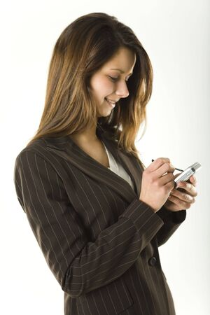 Young bussineswoman using palmtop to sending message. photo