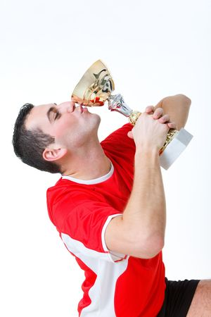 sportingly: Happy man kissing cup. Side view. Stock Photo