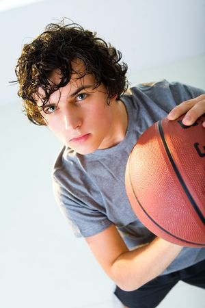 Young man with basketball. He's looking at camera. photo