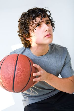 Young man with basketball. He's looking up. photo
