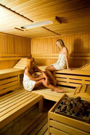 perspiration: Two young women in sauna. They looks happy.