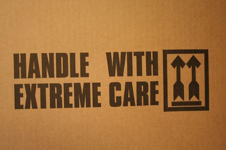 bully: Handle with extreme care text on delivery box Stock Photo