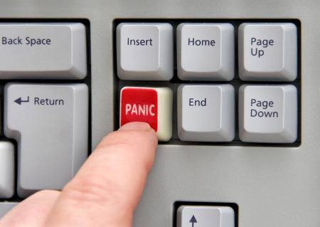 panic button: Finger pressing panic button on computer keyboard