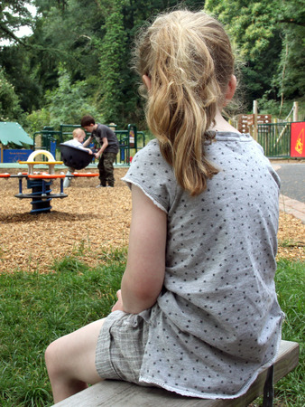 unwanted: Lonely Girl watching other kids playing