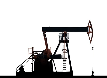 isolated oil pumps silhouette in withe background