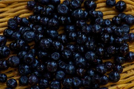 Fresh  organic cranberries on a wicker basket Stock Photo