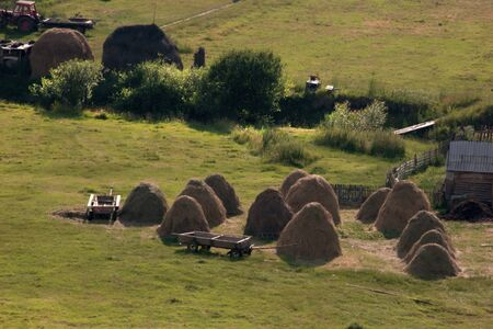 Landscape with cart, tractor and haystack