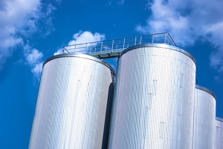 Metall silo with blue sky and clouds