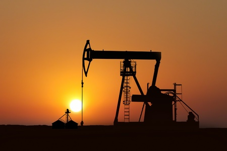 isolated oil pump in action at sunset